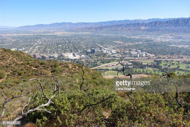 Suburban valley against mountain ranges