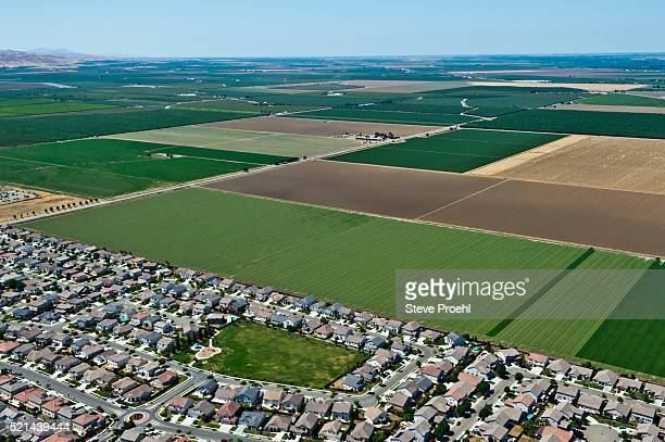 suburbs and farmland - urban sprawl stock pictures, royalty-free photos & images