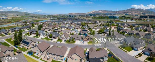 suburbs to salt lake city, utah, seen from air - district stock pictures, royalty-free photos & images