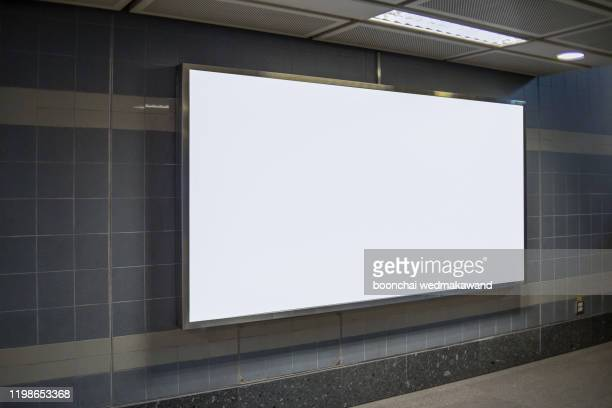 subway billboards at subway stations - underground rail stock pictures, royalty-free photos & images
