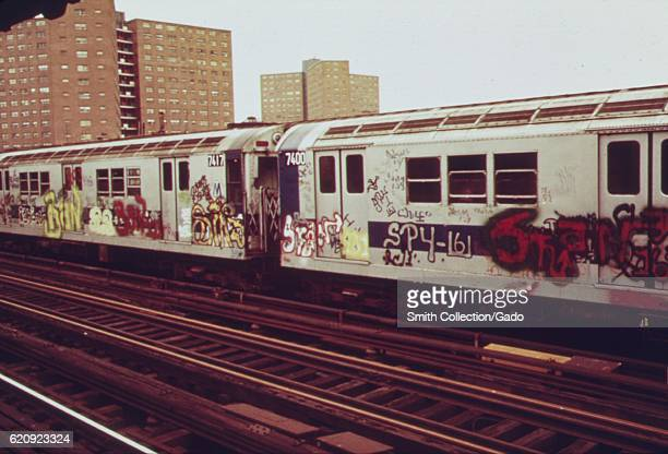 Subway car marked with extensive graffiti tags passes through a station New York City New York May 1973 Image courtesy National Archives