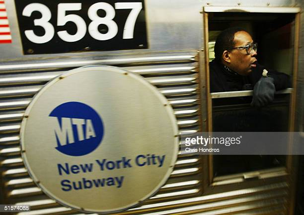 A subway conductor looks out of a window as the train pulls out of a station October 26 2004 in New York City The New York City subway system opened...