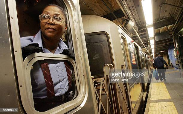A subway conductor looks out onto the platform at the Times Square subway station October 9 2005 in New York City New Yorkers continued to ride the...