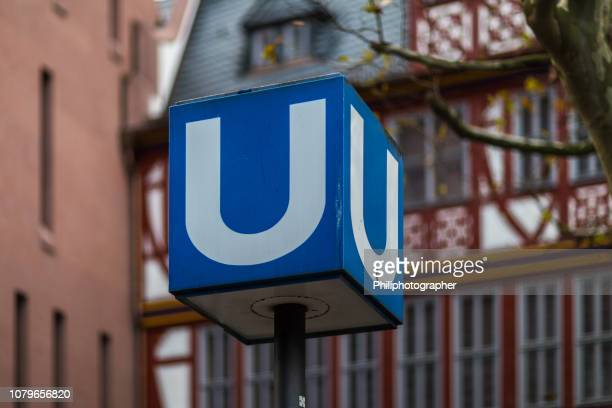 subway entrance in frankfurt, germany - letter u stock photos and pictures