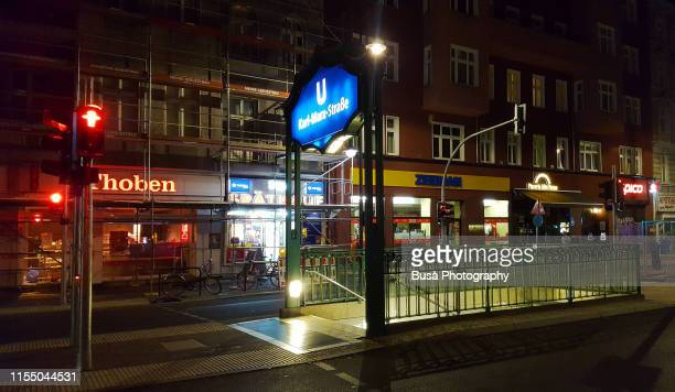 subway entrance sign of u-bahn karl marx strasse station in the district of neukoelln, in berlin, germany - u bahn stock pictures, royalty-free photos & images