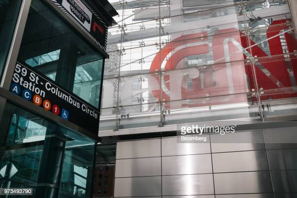 A subway entrance stands in front of a building complex displaying Time Warner Inc brand CNN television network signage in New York US on Wednesday...