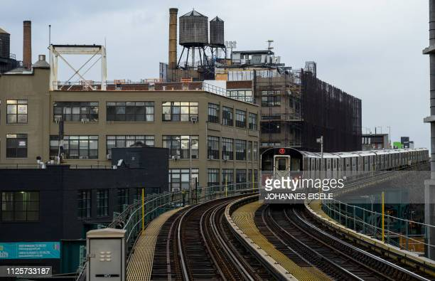 A subway is seen in front of buildings in Long Island City on February 18 2019 in the Queens borough of New York City Seattlebased online retailer...