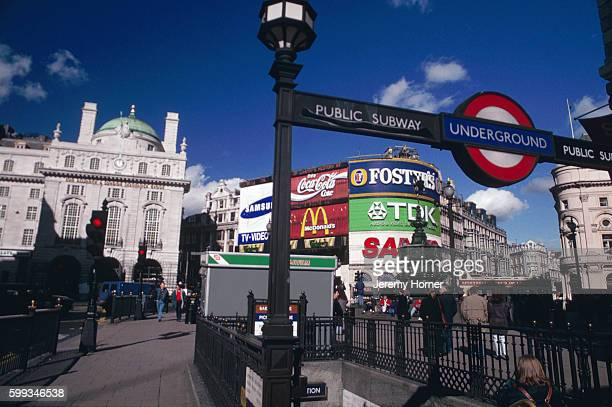 Subway leads to the underground at the edge of Piccadilly Circus in London's West End. Albert Gilbert's memorial fountain stands in the center of the...