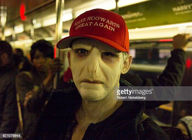 A subway passenger wears a Hogwarts face mask with a likeness to a JK Rowlands character taken from her 'Harry Potter' books in New York October 29...