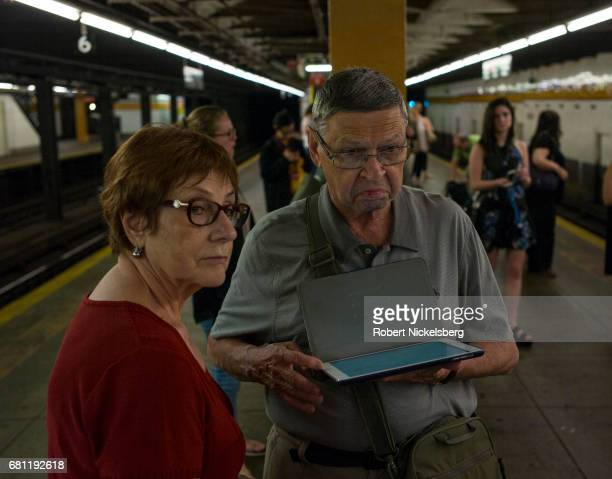 Subway passengers check their iPod map April 29 2017 before boarding a train in the Brooklyn borough of New York City The New York subway averages 57...