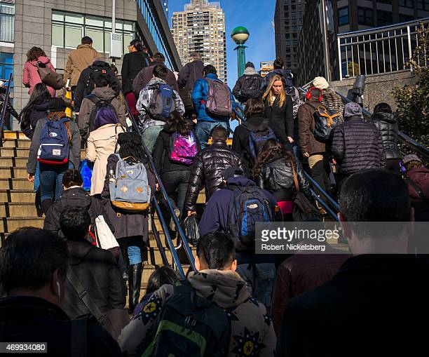 Subway passengers climb the steps outside of the Columbus Circle station March 31, 2015 in the Manhattan borough of New York.