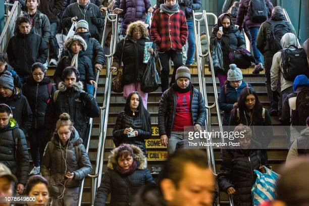 Subway passengers enter the Roosevelt Avenue station Tuesday December 18 in Jackson Heights New York It is considered one of the most diverse...