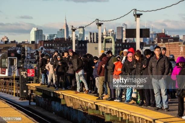 Subway passengers wait for a train at the Junction Boulevard station Tuesday December 18 in Jackson Heights New York It is considered one of the most...