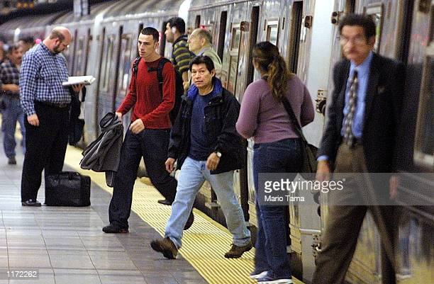 Subway riders exit a train at the Canal Street stop October 22, 2001 in New York City. Riders have encountered delays and reroutings because of...