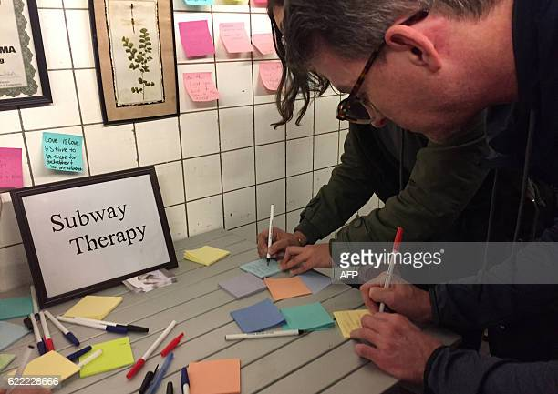 Subway riders leave postit notes on the walls of a subway tunnel on November 10 2016 in New York City New York commuters are venting anger and...