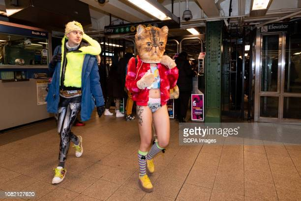 Subway riders without pants participating in the annual No Pants Subway Ride at the Union Square subway station in New York City