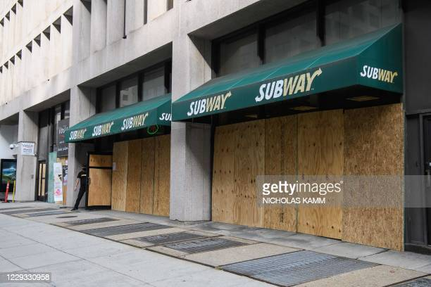 Subway sandwich shop is boarded up in Washington, DC, on October 28 six days before the US presidential election, as businesses fear post-electoral...