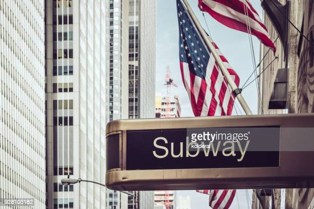 subway sign. usa national flags. fifth avenue in midtown manhattan - underground sign stock pictures, royalty-free photos & images