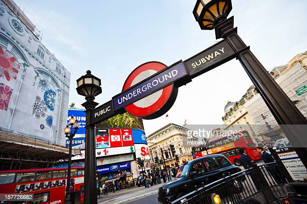 subway station at piccadilly circus in london, uk - underground stock photos and pictures