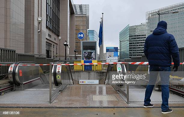 """Subway station entrance is seen closed as the Belgian authorities raised the terror alert to the level 4, highest level warning of an """"imminent..."""