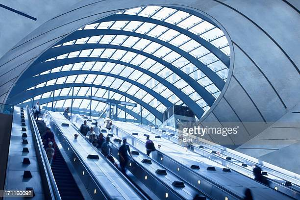 subway station escalators, canary wharf, london, england - canary wharf stock photos and pictures