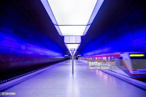 Subway station with blue lighting in Hamburg, Germany