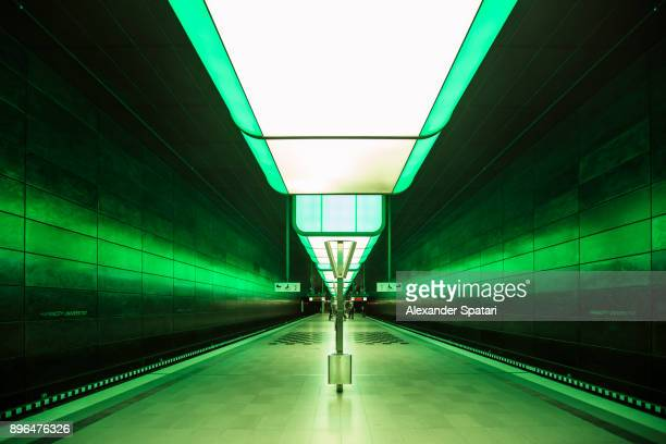 Subway station with green light in Hamburg, Germany