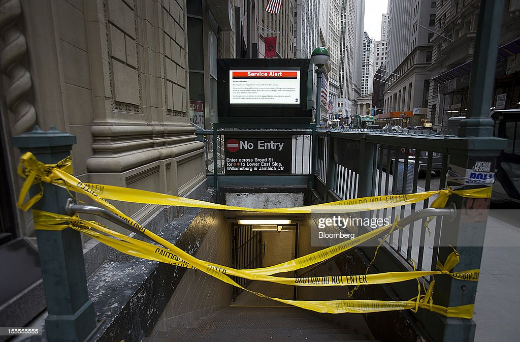 A subway station's entrance is blocked by yellow tape in New York, U.S., on Monday, Nov. 5, 2012. Commuters in New York and New Jersey face gasoline lines and miles of traffic jams as the metropolitan area struggles with the chaos that remains in the wake of superstorm Sandy. Photographer: Scott Eells/Bloomberg via Getty Images