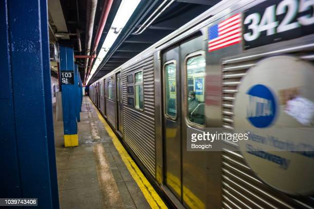 nyc subway train departing from 103 street station in manhattan - new york city subway stock pictures, royalty-free photos & images