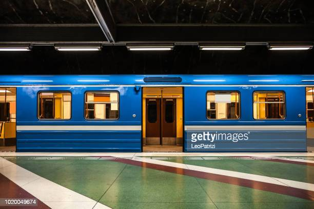 subway train departure in stockholm subway platform - subway train stock pictures, royalty-free photos & images