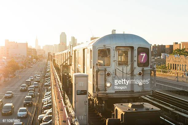 NYC Subway Train Drives Toward Queens During Rush Hour Sunset