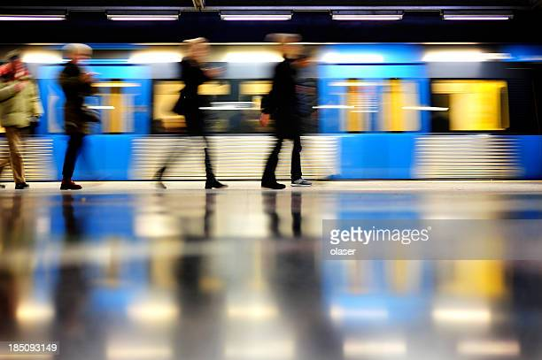 subway train in profile, and commuters - underground stock photos and pictures