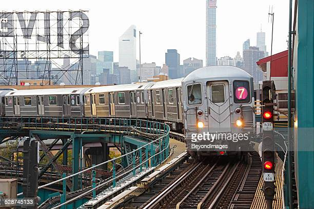 nyc mta subway train on line 7 in queens - new york city subway stock pictures, royalty-free photos & images