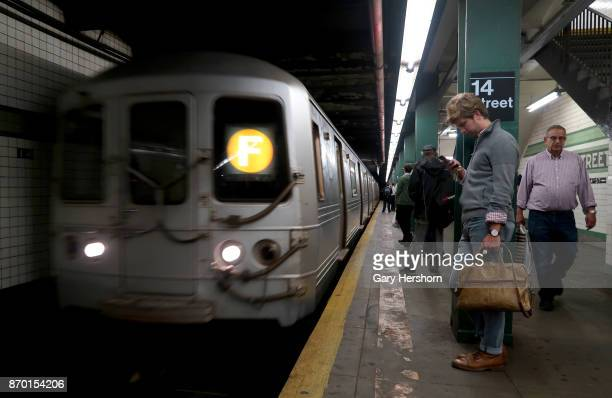 A subway train pulls into the 14th Street station on November 2 2017 in New York City