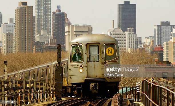 A subway train travels above ground with the Manhattan skyline in the background March 24 2004 in New York City The New York subway system is...