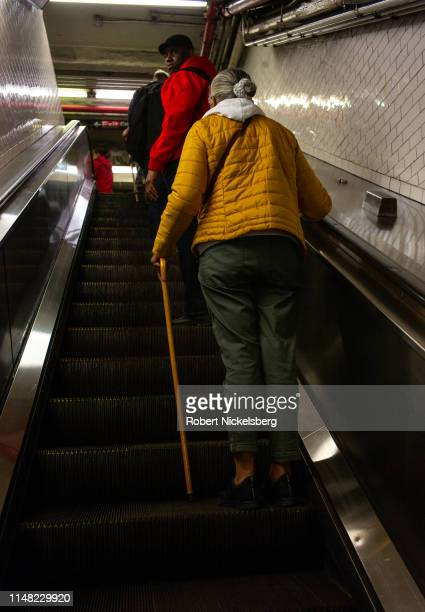 Subway travelers use an escalator at the Borough Hall subway station in Brooklyn, New York on May 2, 2019. The Metropolitan Transportation Authority...