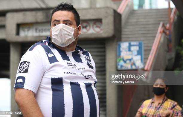 Subway user wearing a face mask looks on before its closes as a measure to prevent the spread of the Coronavirus on April 27 2020 in Monterrey Mexico...