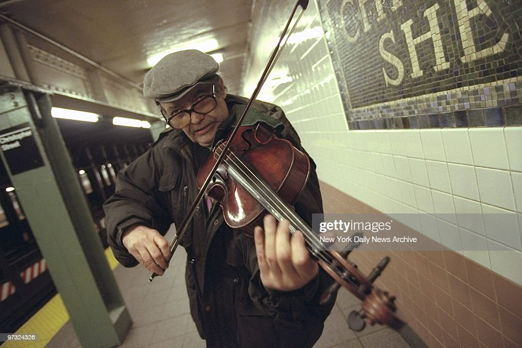 Subway violinist, John Arms, plays in the Christopher St. station.