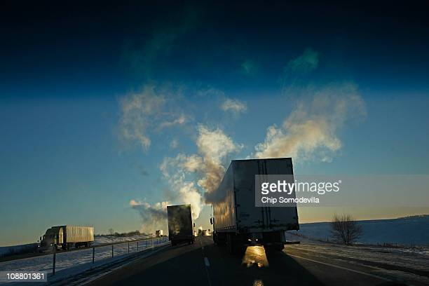 Sub-zero temperatures move in behind a massive snowstorm, giving tractor-trailer trucks a smoky appearance along I-80 February 3, 2011 outside of...