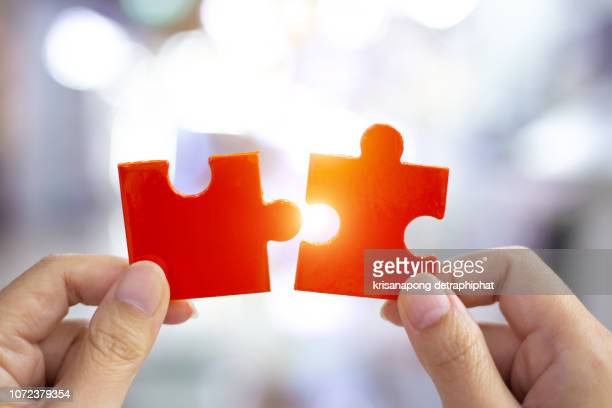 success and strategy concept. business woman hand connecting jigsaw puzzle. - colleague stock pictures, royalty-free photos & images