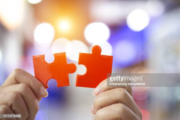 success and strategy concept. business woman hand connecting jigsaw puzzle. - 電動糸のこ ストックフォトと画像