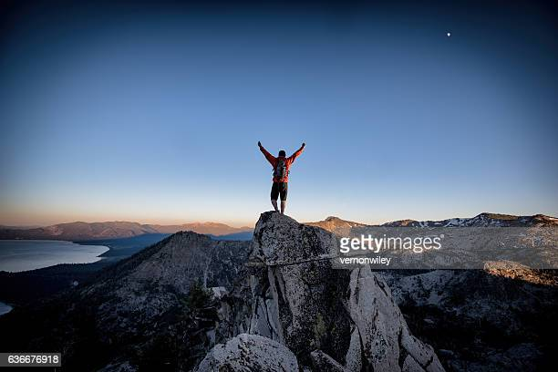 success and victory in the mountains - mountain peak stock pictures, royalty-free photos & images