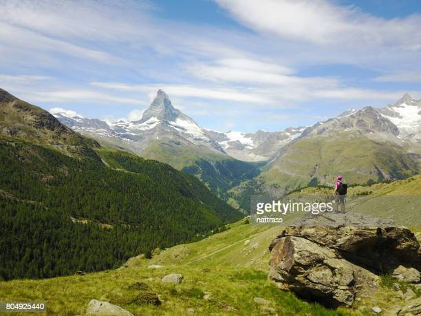 success - female hiker standing on a rock - matterhorn stock pictures, royalty-free photos & images