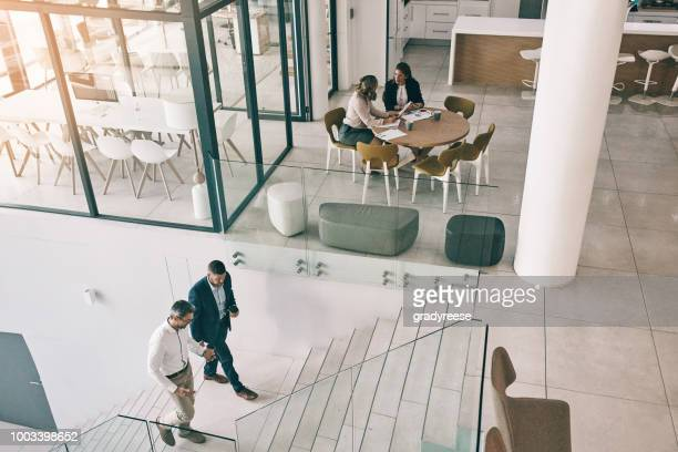 success is all around this office - modern stock pictures, royalty-free photos & images