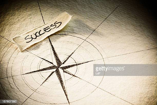 success label on a wind rose - compass rose stock pictures, royalty-free photos & images