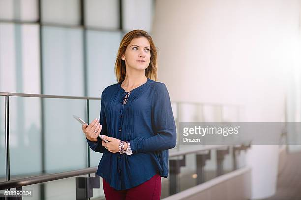 Success oriented businesswoman with laptop in office building