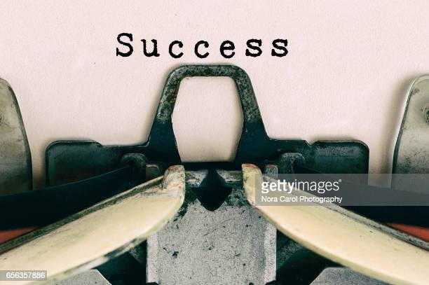 success type on vintage typewriter - handbook stock photos and pictures