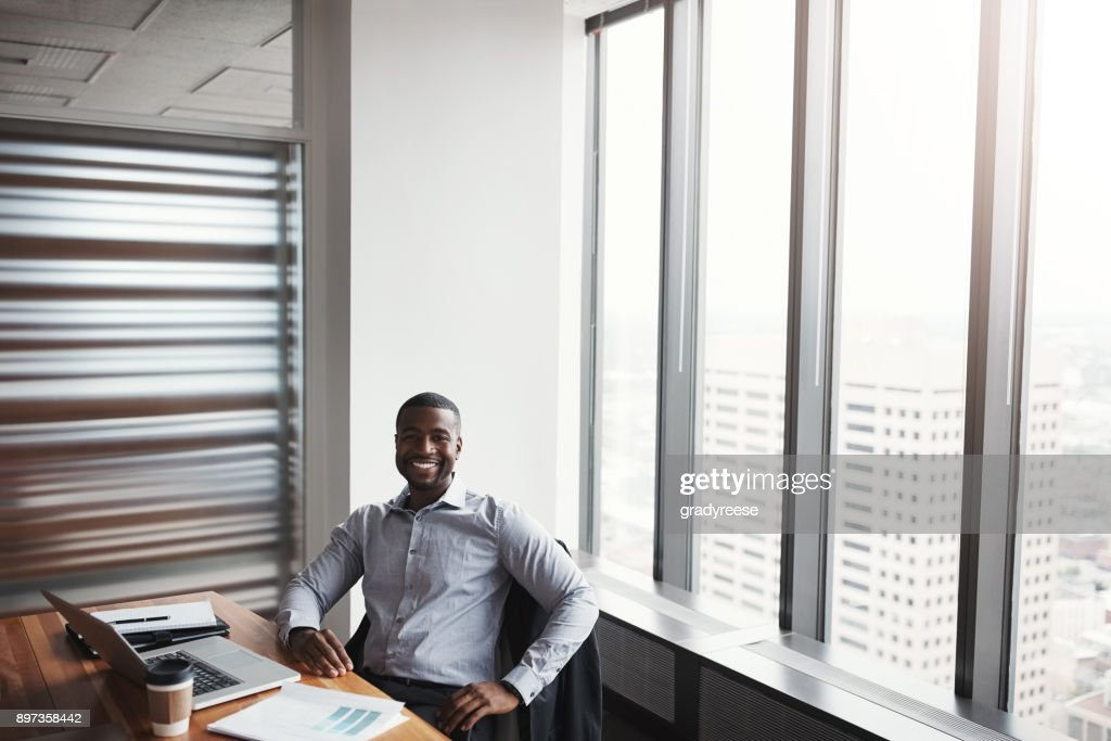 High angle portrait of a handsome businessman working in his corporate office
