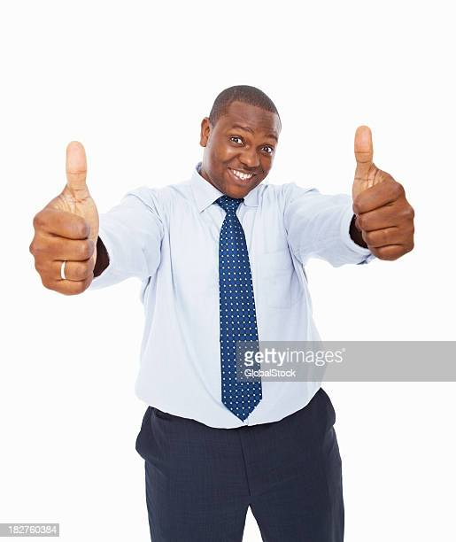 Successful African American businessman showing thumbs up sign