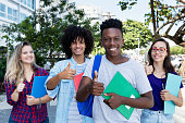 Successful african american student with group of internternational students